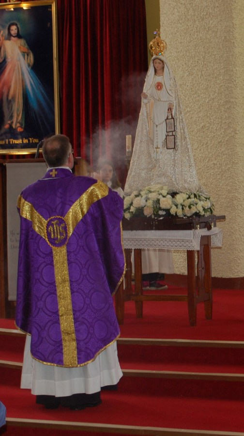 mini-_Fr. Gabriel incensing the statue