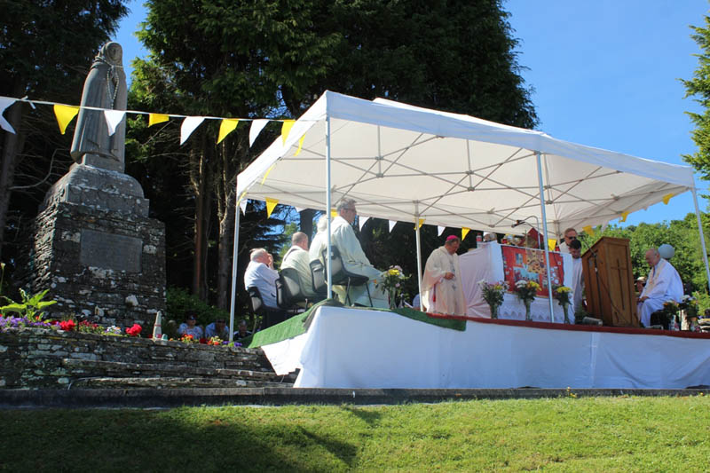 Bishop William Crean celebrates Mass beside the statue of St Gobnait