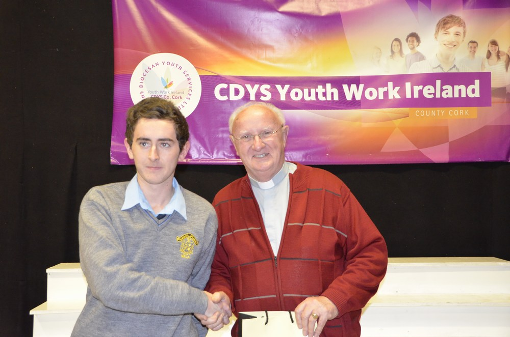 Darragh O'Brien presenting Archdeacon Casey with a gift to mark his Golden Jubliee celebration on behalf of CDYS